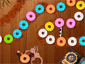 Doughnut Inspector - Mostre sua agilidade nesse jogo estilo zuma. Mire e atire rosquinhas em suas cores correspondente para eliminar do cenário, seja rápido para concluir todo o estágio.