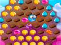 Sugar Tales - Devore todas as guloseimas do tabuleiro. Ajude o monstrinho comer o maior n�mero de doces em cada n�vel do game, fique atento pois os seus movimentos s�o limitados.